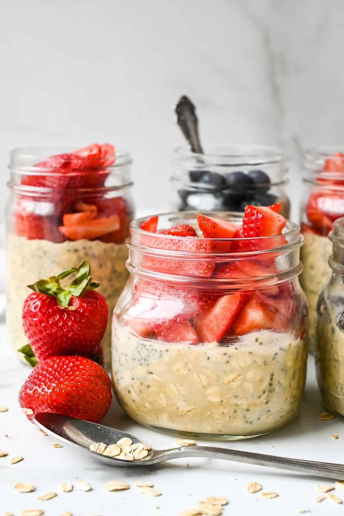 overnight oats in jars topped with berries