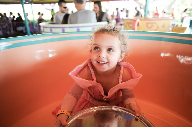 Girl in Princess Dress on Teacup Ride