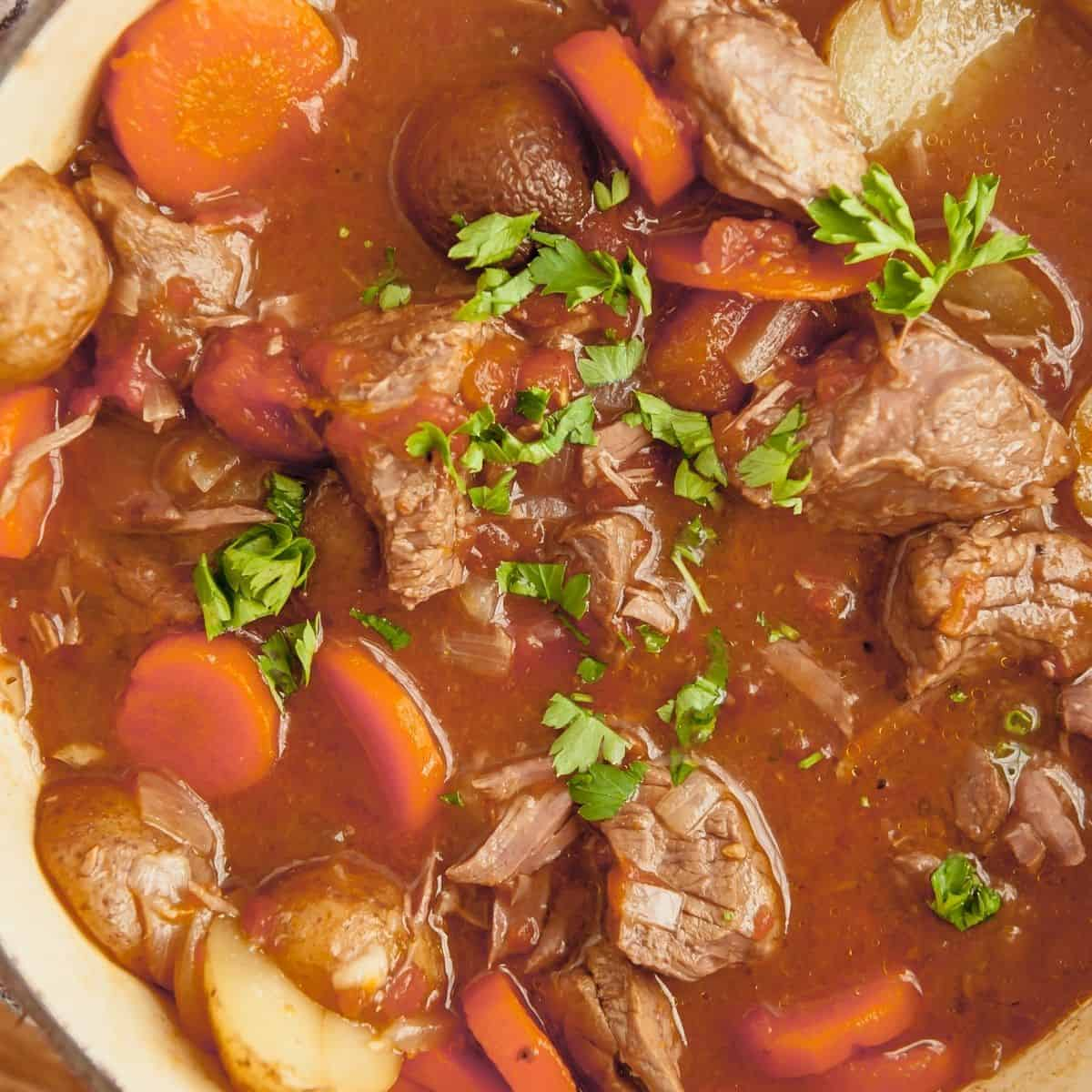 whole30 beef stew with potatoes, carrots and onions in a dutch oven