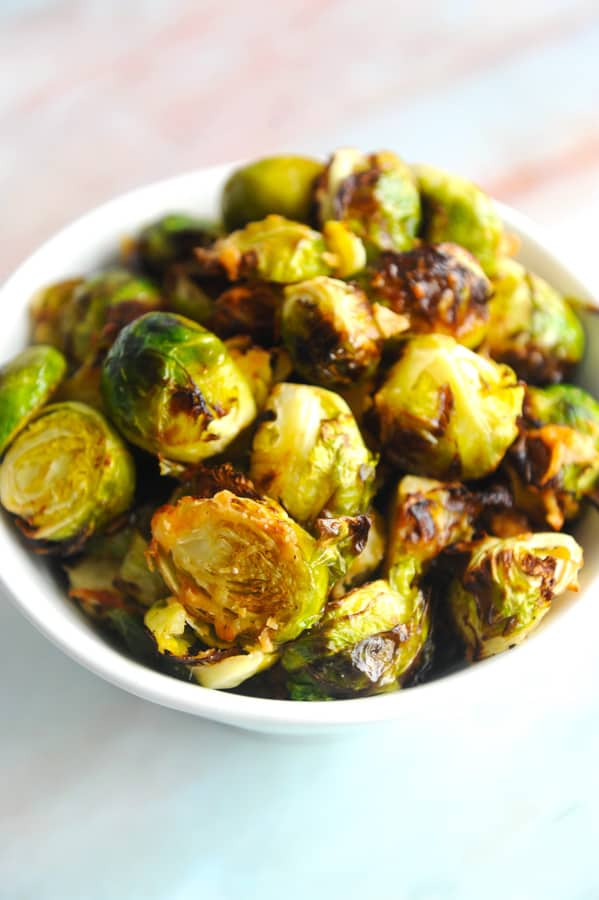 Looking for a delicious air fryer brussel sprouts recipe to use for your air fryer from amazon? healthy Lifestyle Blogger Momma Fit lyndsey is sharing her keto air fryer brussel sprouts recipe