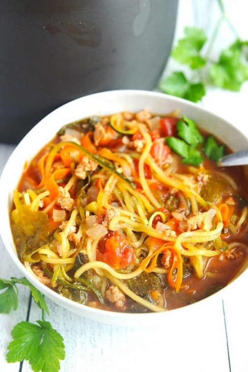 healthy crockpot soup that can be made in the slow cooker and is easy. Clean eating approved and made with vegetables. simple and comforting kale and sausage soup with zoodles