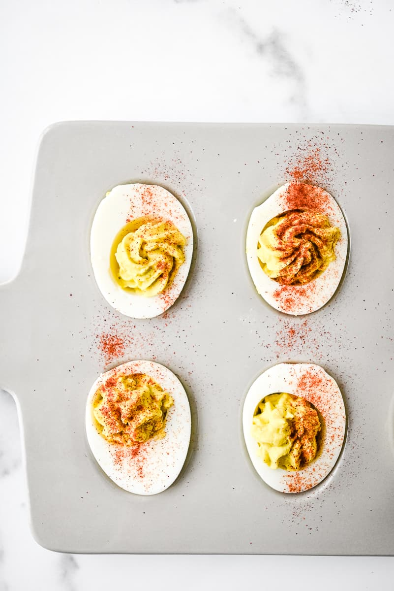 deviled eggs in an egg tray