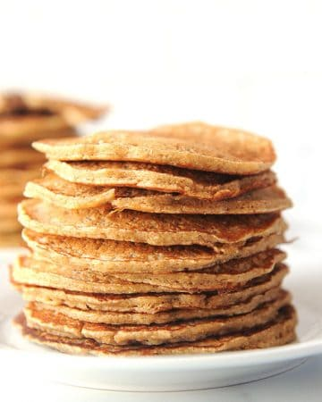 Oat flour pancakes are an easy healthy breakfast to make on a budget! Homemade oat flour make these pancakes gluten free, vegan, free of refined sugar and delicious!