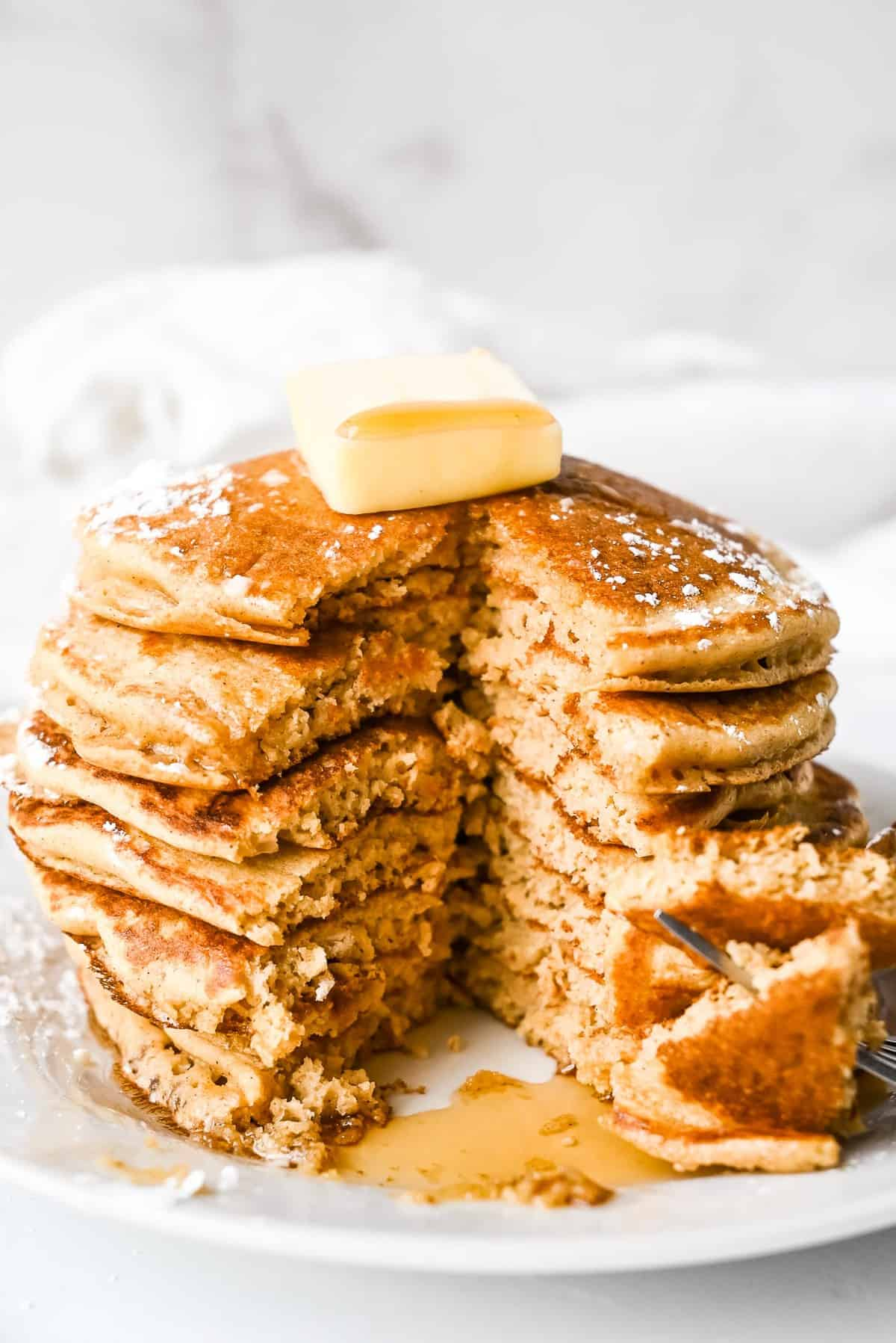 stack of pancakes with a large cut to see the inside