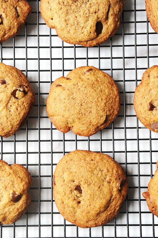 tahini chocolate chip cookies cooling on a cooling rack