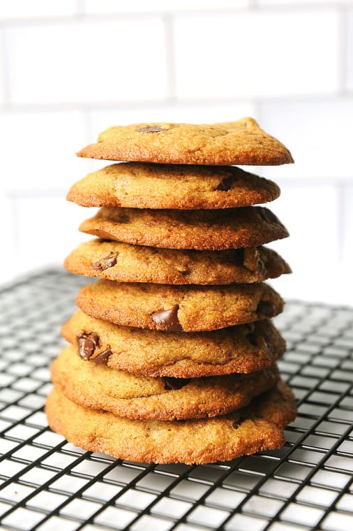 almond flour chocolate chip cookies in a stack on a cooling rack