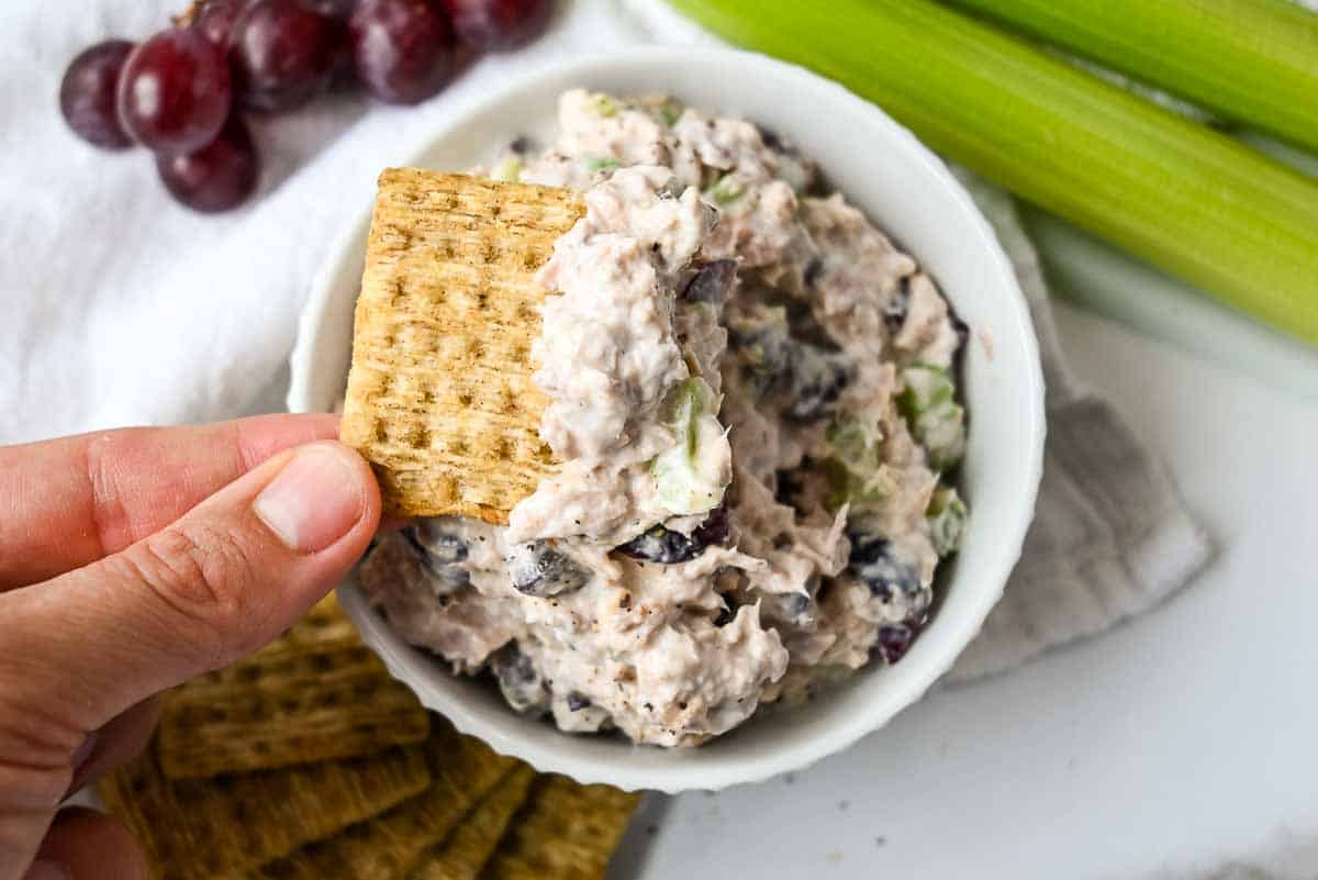 tuna salad in a bowl with crackers for serving