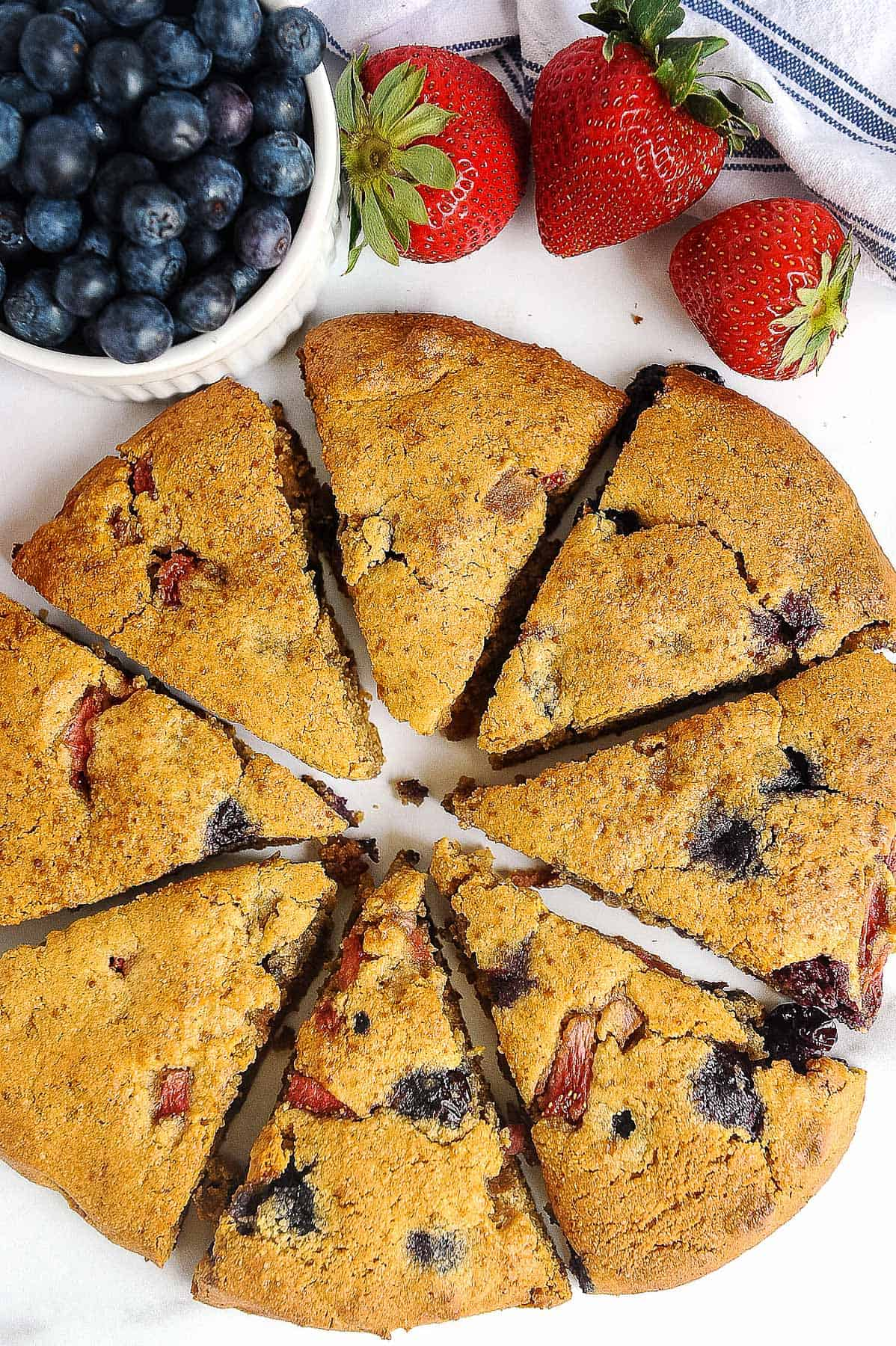 cut berry scones on a white plate