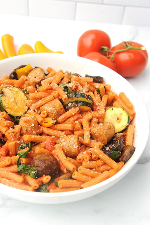 grilled veggie pasta with summer vegetables, plant based pasta and chicken sausage. This chicken sausage pasta is an easy weeknight meal that is done in less than 30 minutes.
