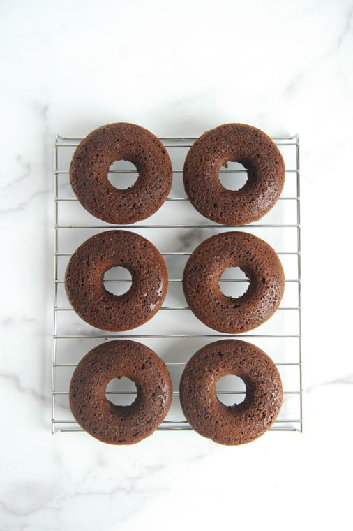 These chocolate cake donuts with no yeast are paleo donuts for any season! Topped with glaze and sprinkles these keto chocolate donuts are just delicious!