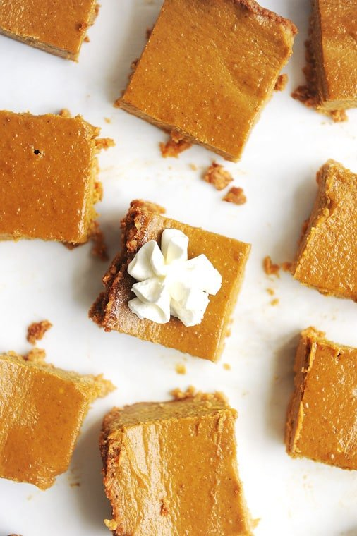 This Paleo Pumpkin Pie Bars Recipe is creamy, delicious and easy to make! A delicious paleo pie crust paired with a layer of paleo pumpkin pie makes this recipe gluten-free, dairy-free and free of refined sugar.