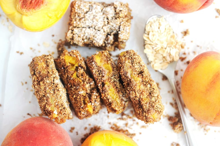 Peach Crumble Bars have fresh peach filling between two vegan oatmeal crusts. These peach pie bars are a delicious healthy spin on traditional peach pie.