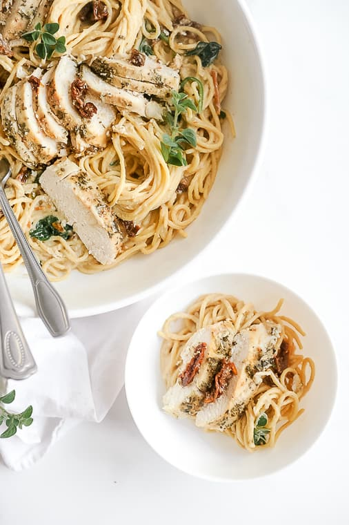 crockpot tuscan chicken pasta made with creamy dairy free cashew alfredo sauce in the slow cooker. Healthy and easy to make in the crock pot with spinach, sun-dried tomatoes and coconut milk. Serve with chickpea pasta or on its own for a whole30 or keto crockpot tuscan chicken.