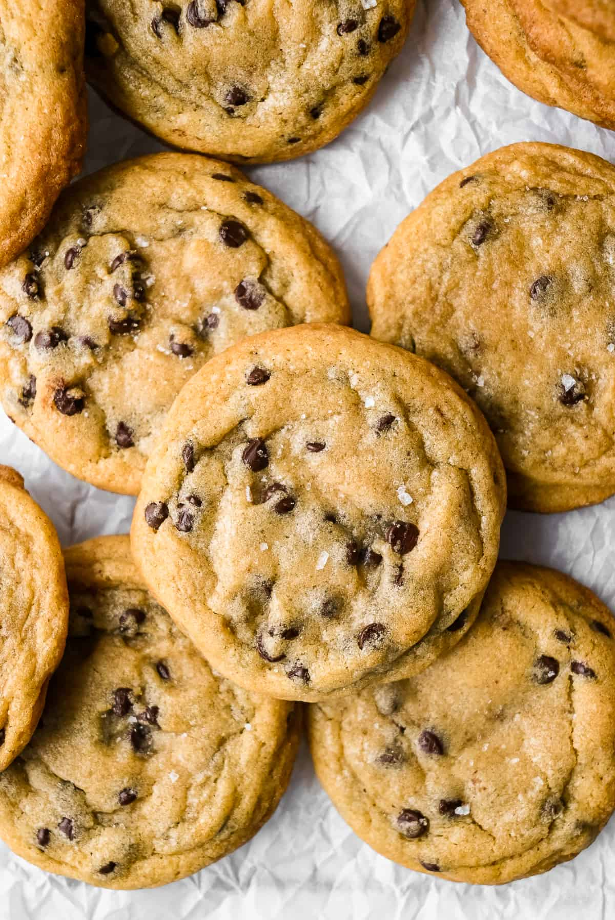 batch of dairy free chocolate chip cookies on parchment paper