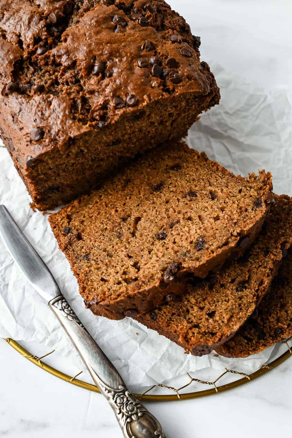 slices of healthy zucchini bread with applesauce