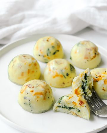 Instant Pot Egg Bites that are Keto, Whole30, Dairy Free and Gluten Free. Easy and healthy to make with bacon and spinach and better than Starbucks!