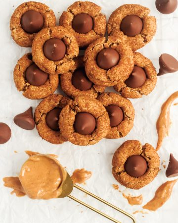 gluten free peanut butter blossoms on parchment paper