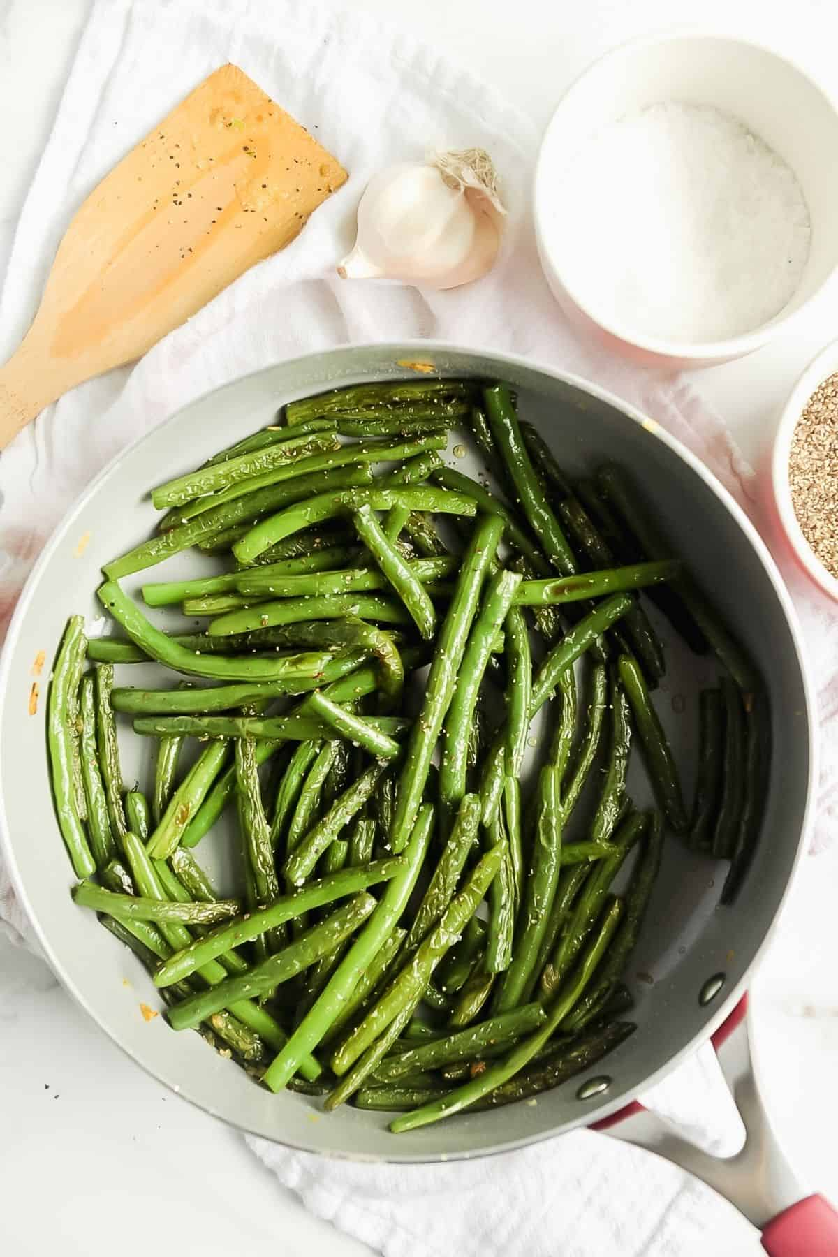skillet of blistered green beans with garlic
