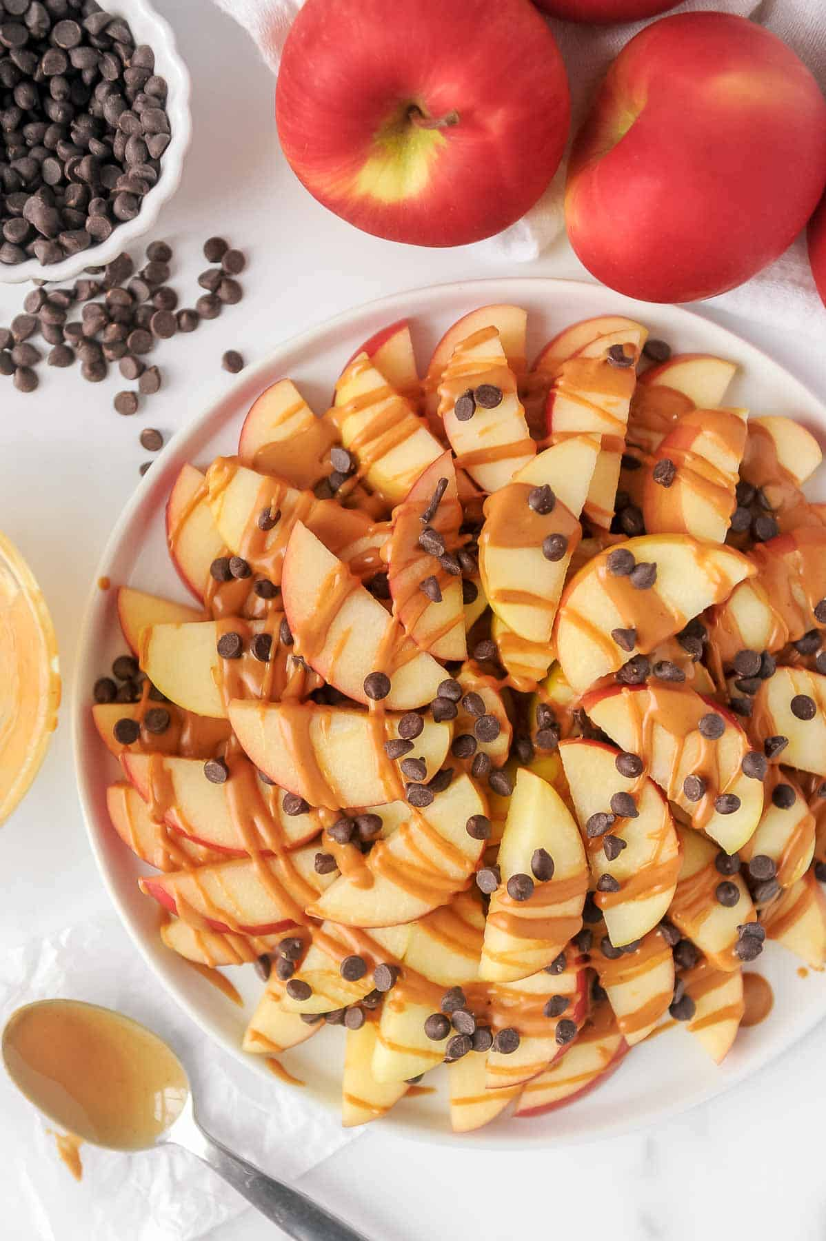 plate and ingredients to make healthy apple nachos
