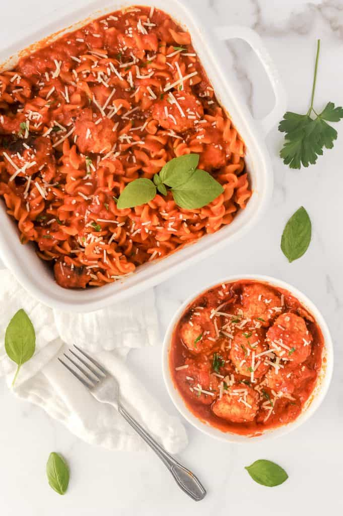 pasta and meatballs in a casserole dish and on a plate