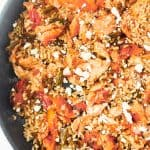 skillet with salmon and rice