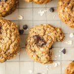 chewy almond butter oatmeal cookie with a bite taken out