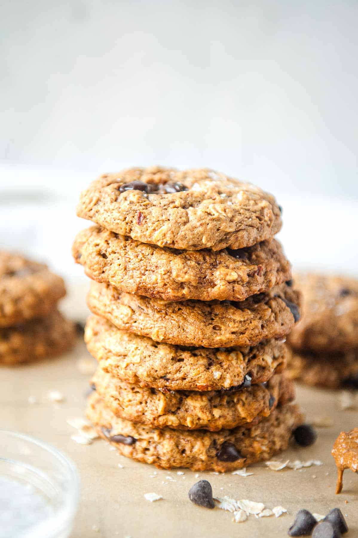 stack of oatmeal almond butter cookies on parchment paper