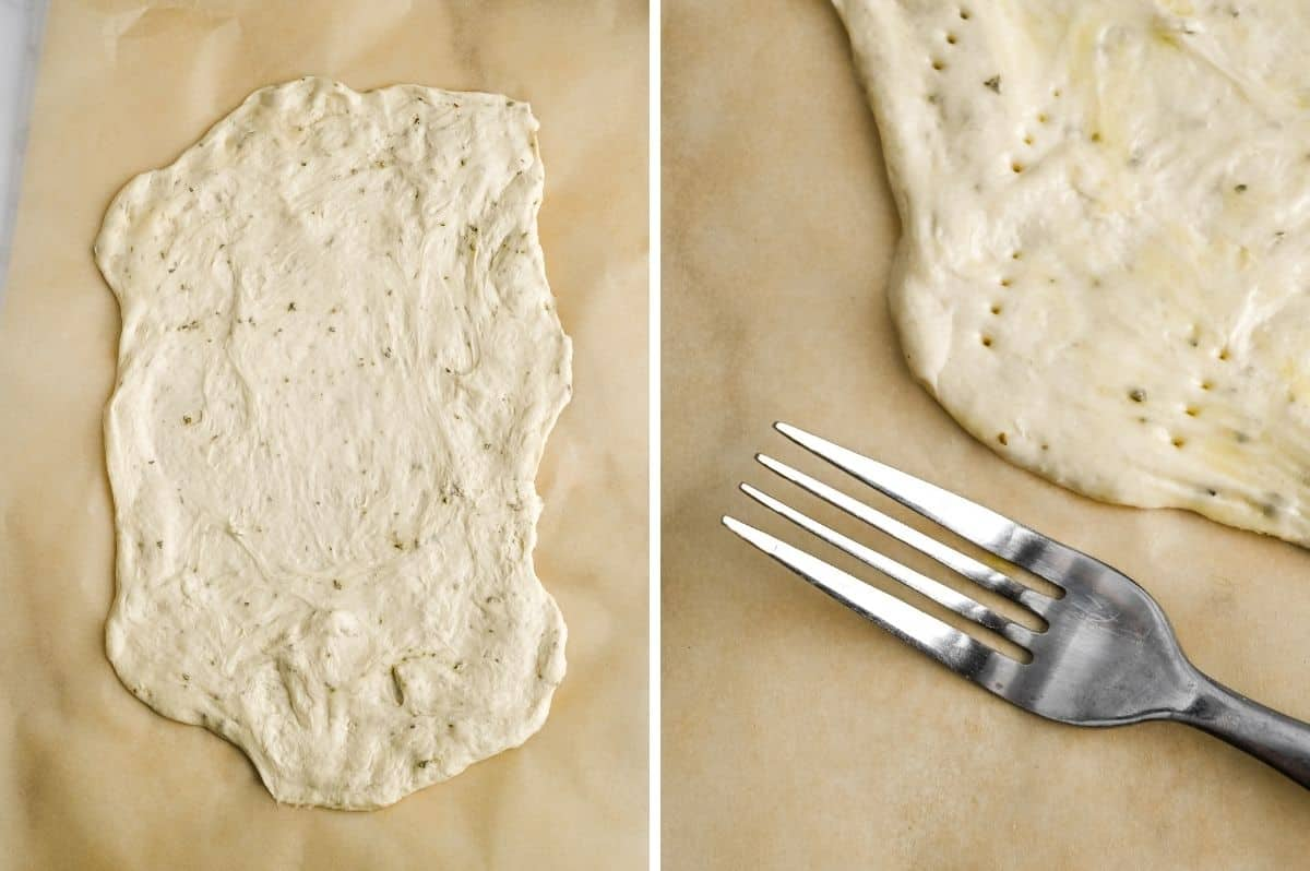 stretched pizza dough on a piece of parchment paper
