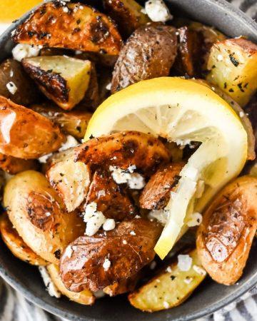 crispy lemon garlic potatoes with Greek flavors in a bowl