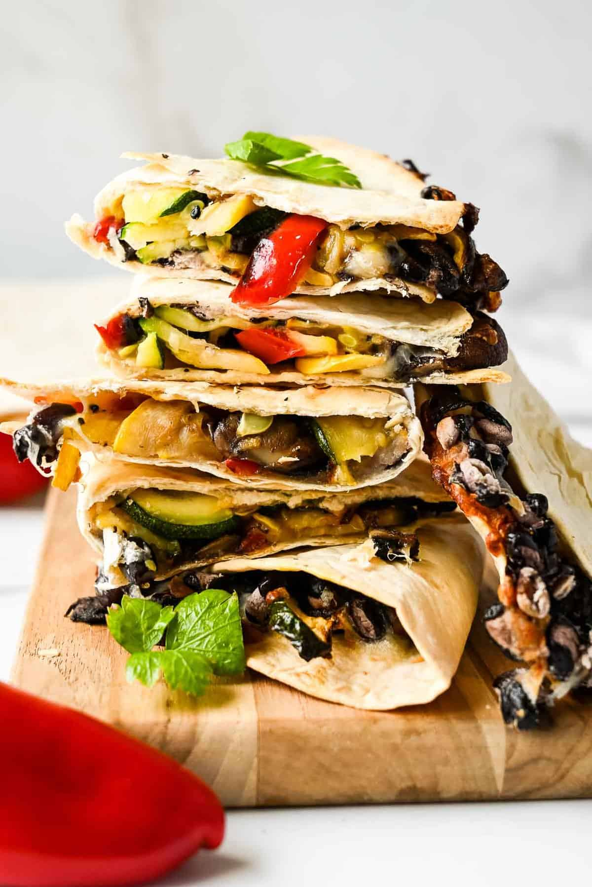 stack of veggie quesadillas with peppers and beans
